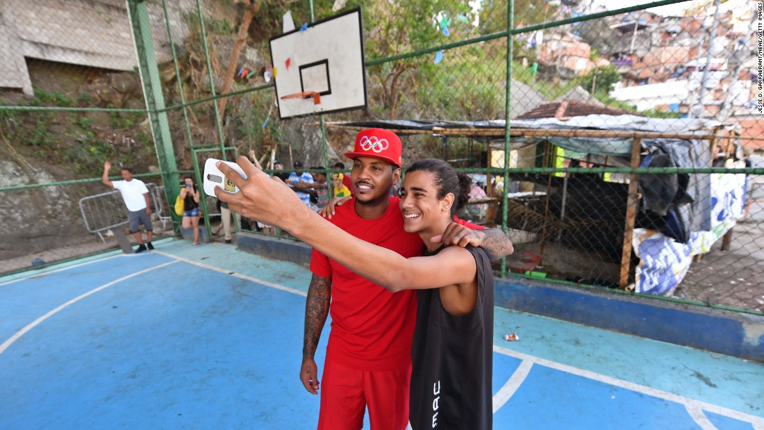 "U.S. basketball star Carmelo Anthony poses for a photo as he tours Rio de Janeiro on Monday, August 15. Anthony and the American team <a href=""http://www.cnn.com/2016/08/21/sport/rio-2016-us-basketball-durant-serbia/"" target=""_blank"">went on to win the gold medal</a> -- the third of Anthony's career."