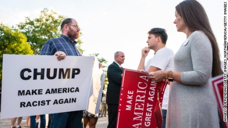 A supporter confronts a protester outside of a rally for Donald Trump at in Akron, Ohio on August 22, 2016.