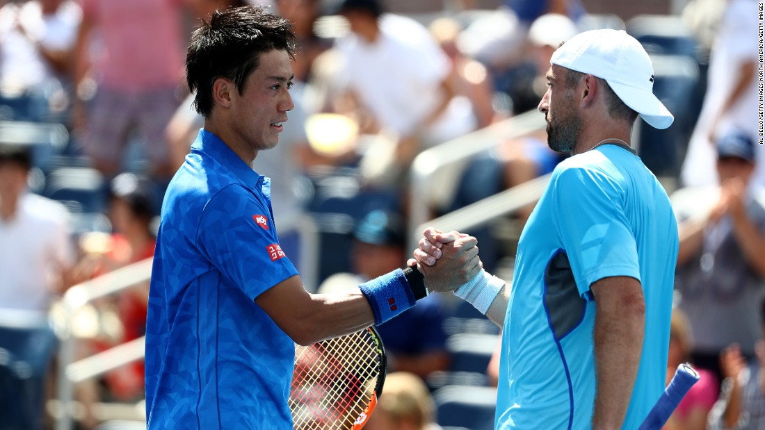 Japan's Kei Nishikori, seeded sixth, shakes hands with Benjamin Becker after beating the German 6-1 6-1 3-6 6-3 on Tuesday.