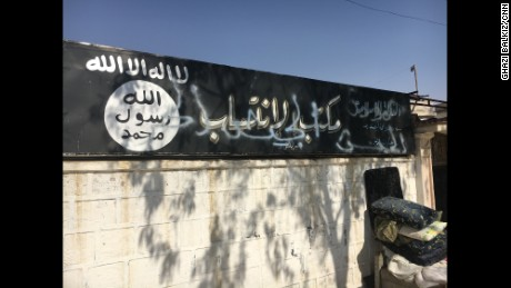 "The sign in front of the ISIS recruitment center in Jarablus now has the words ""Free Syrian Army"" sprayed over it."