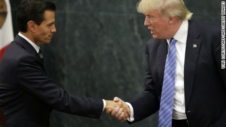 Mexican President Enrique Pena Nieto (L) and US presidential candidate Donald Trump shake hands after a meeting in Mexico City on August 31, 2016. Donald Trump was expected in Mexico Wednesday to meet its president, in a move aimed at showing that despite the Republican White House hopeful's hardline opposition to illegal immigration he is no close-minded xenophobe. Trump stunned the political establishment when he announced late Tuesday that he was making the surprise trip south of the border to meet with President Enrique Pena Nieto, a sharp Trump critic.  / AFP / YURI CORTEZ        (Photo credit should read YURI CORTEZ/AFP/Getty Images)