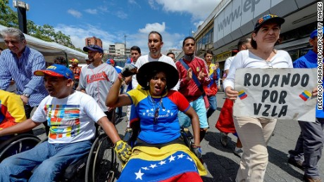 Opposition supporters on wheelchairs take part in a demostration to demand to the National Election Council (CNE) the acceleration of the process of a recall referendum against President Nicolas Maduro, in Caracas on August 31, 2016. Venezuelan President Nicolas Maduro vowed Tuesday to jail opposition leaders if they incite violence during upcoming protests seeking a referendum on removing him from power. / AFP / FEDERICO PARRA        (Photo credit should read FEDERICO PARRA/AFP/Getty Images)