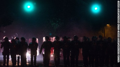 Police line the streets during a protest march of supporters of ex-President Dilma Rousseff in Sao Paulo.