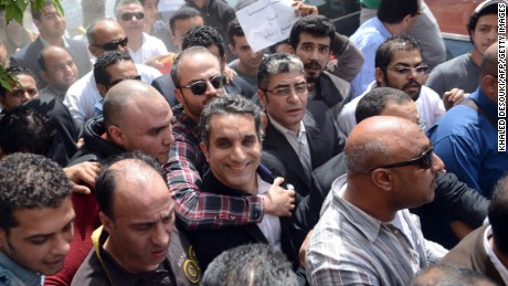 Youssef is surrounded by supporters upon his arrival at the public prosecutor's office in the high court in Cairo, Egypt on March 31, 2013.