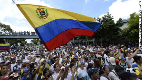 Opposition activists attend a rally in Caracas, on September 1, 2016. Venezuela's opposition and government head into a crucial test of strength Thursday with massive marches for and against a referendum to recall President Nicolas Maduro that have raised fears of a violent confrontation. / AFP / FEDERICO PARRA        (Photo credit should read FEDERICO PARRA/AFP/Getty Images)