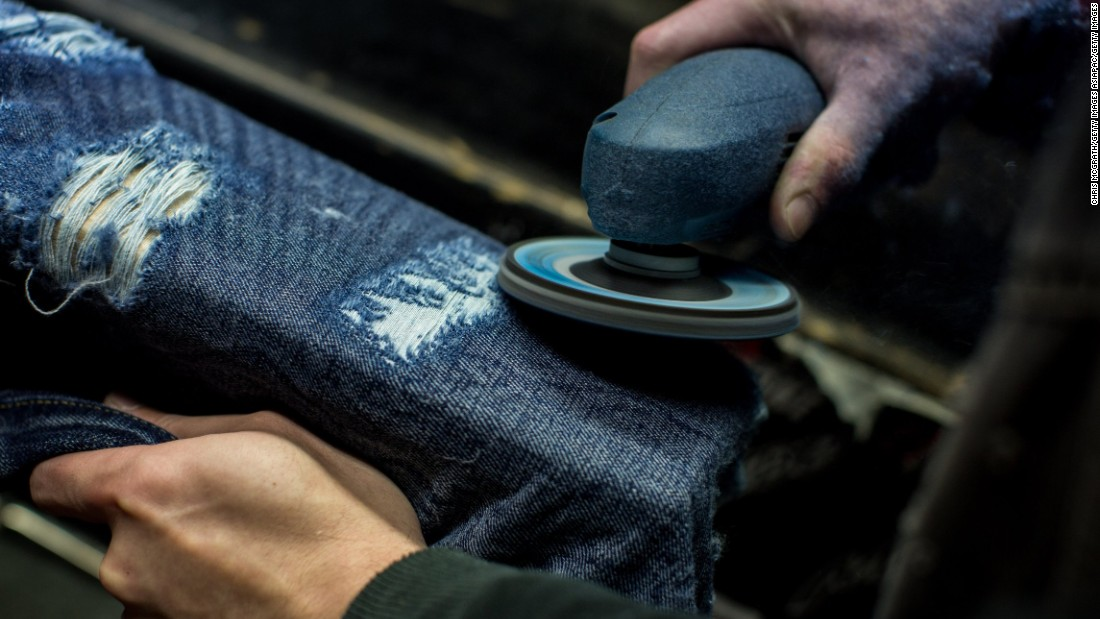 As other denim factories around the world shift towards a mass-production model, mills in Japan still offer quality fabric, some of which are treated by hand. Here, an employee at an Okayama mill distresses denim by hand.
