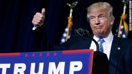PHOENIX, AZ - AUGUST 31:  Republican presidential nominee Donald Trump gives a thumbs up to the crowd during a campaign rally on August 31, 2016 in Phoenix, Arizona. Trump detailed a multi-point immigration policy during his speech. (Photo by Ralph Freso/Getty Images)