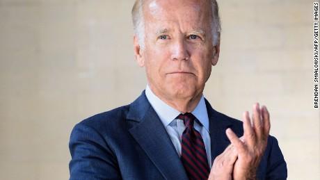 Vice President Joe R. Biden claps while waiting to speak at  Amtrak's Joseph R. Biden, Jr,. Railroad Station on August 26, 2016 in Wilmington, Delaware.