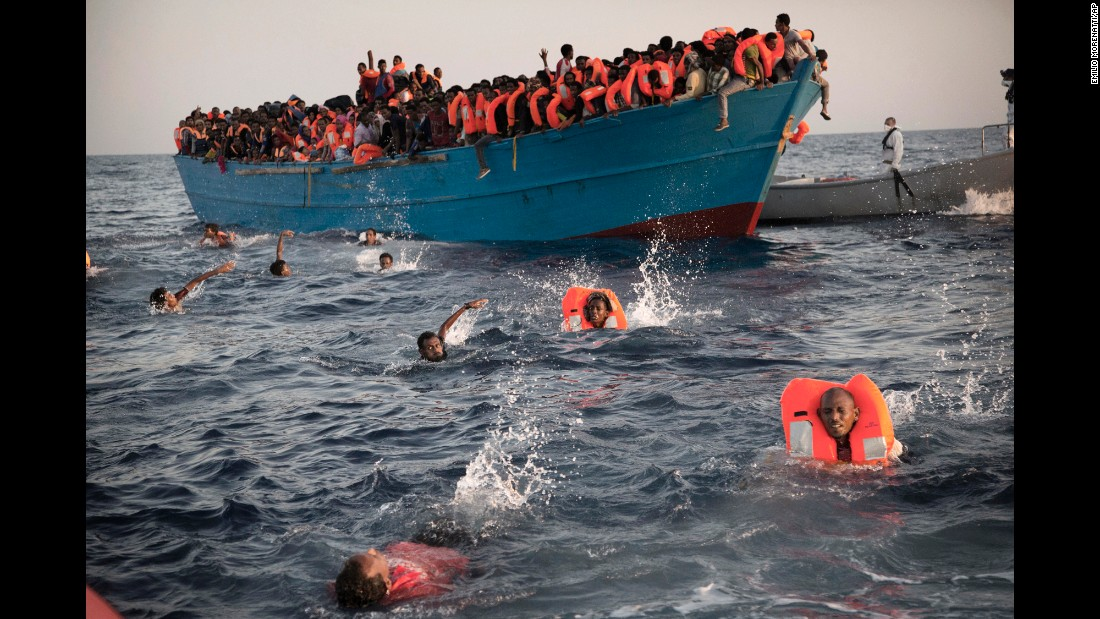 "Migrants swim away from a crowded wooden boat as they are rescued in the Mediterranean Sea north of Sabratha, Libya, on Monday, August 29. Thousands were rescued from more than 20 boats. <a href=""http://www.cnn.com/2015/09/03/world/gallery/europes-refugee-crisis/index.html"" target=""_blank"">See more photos from Europe's migration crisis</a>"