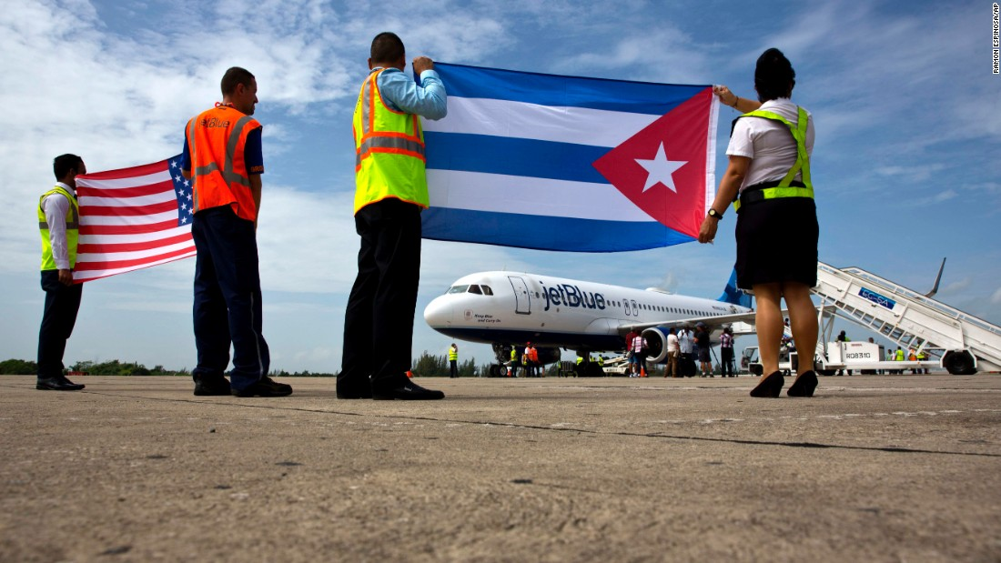 "Airport workers hold a Cuban flag and an American flag after JetBlue Flight 387 -- <a href=""http://www.cnn.com/2016/08/30/politics/cuba-flights-commercial-security/"" target=""_blank"">the first direct commercial flight</a> between the United States and Cuba in more than 50 years -- landed in Santa Clara, Cuba, on Wednesday, August 31. The two nations restored diplomatic ties last year."
