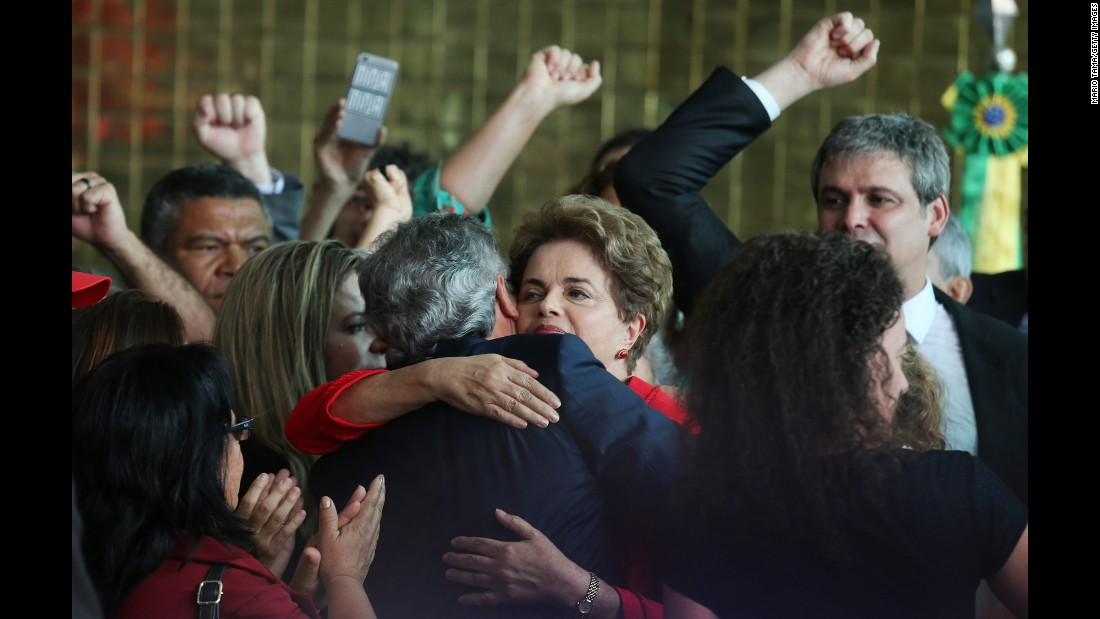 "Impeached Brazilian President Dilma Rousseff, in red, hugs a supporter after delivering her farewell address on Wednesday, August 31. <a href=""http://www.cnn.com/2016/08/31/americas/brazil-rousseff-impeachment-vote/"" target=""_blank"">Brazil's Senate voted 61-20</a> to remove her from office, finding her guilty of breaking budgetary laws. Michel Temer, Rousseff's former vice president who has been serving as interim president since her suspension in May, will serve out the remainder of her term."