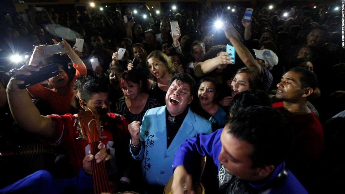 "Fans sing songs by Juan Gabriel outside the home of the Mexican music icon on Sunday, August 28. The 66-year-old from Ciudad Juarez <a href=""http://www.cnn.com/2016/08/28/entertainment/latin-american-music-icon-juan-gabriel-dead/"" target=""_blank"">died just hours before he was set to perform</a> in El Paso, Texas."