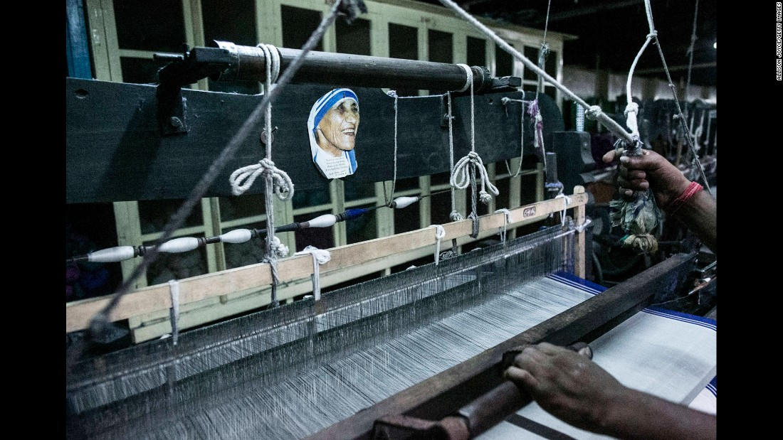 "A photo of the late Mother Teresa is seen in Kolkata, India, as a former patient of the Prem Nevas Leprosy Centre makes saris for nuns on Wednesday, August 31. Mother Teresa <a href=""http://www.cnn.com/specials/world/mother-teresa-sainthood"" target=""_blank"">is set to be canonized</a> by Pope Francis on Sunday. <a href=""http://www.cnn.com/interactive/2016/09/world/mother-teresa-photos/"" target=""_blank"">A force for good: Mary Ellen Mark's photos of Mother Teresa</a>"