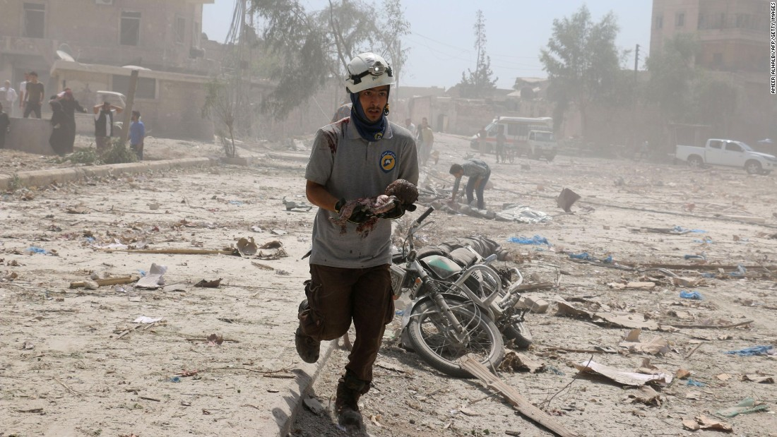 "A rescue worker carries a dead baby in Aleppo, Syria, after an airstrike on Saturday, August 27. Aleppo has been besieged for years during the Syrian civil war. <a href=""http://www.cnn.com/2016/08/28/middleeast/aleppo-barrel-bomb-wake-bombed/"" target=""_blank"">Fighting has intensified in recent weeks,</a> and the death toll is climbing."
