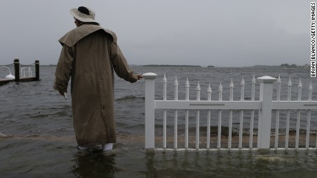 Doug LeFever inspects the seawall near his home at the Sandpiper Resort as he surveys the rising water coming from the Gulf of Mexico into his neighborhood as winds and storm surge associated with Tropical Storm Hermine impact the area on September 1, 2016 at in Holmes Beach, Florida.  Hurricane warnings have been issued for parts of Florida's Gulf Coast as Hermine is expected to make landfall as a Category 1 hurricane.