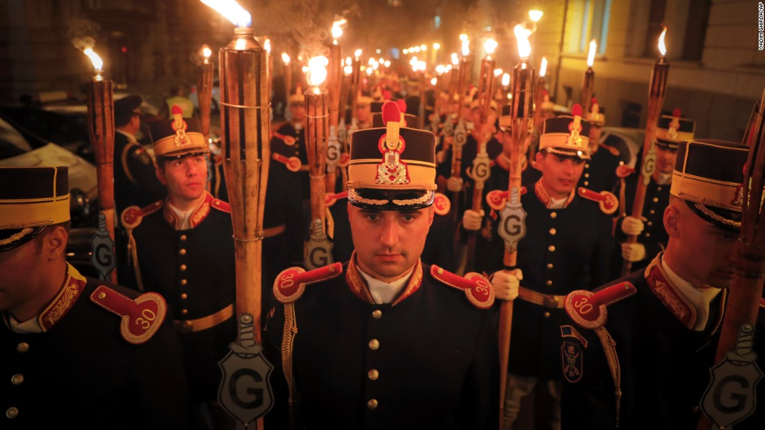 Romanian servicemen hold torches Monday, August 29, during events held 100 years after the nation got involved in World War I.