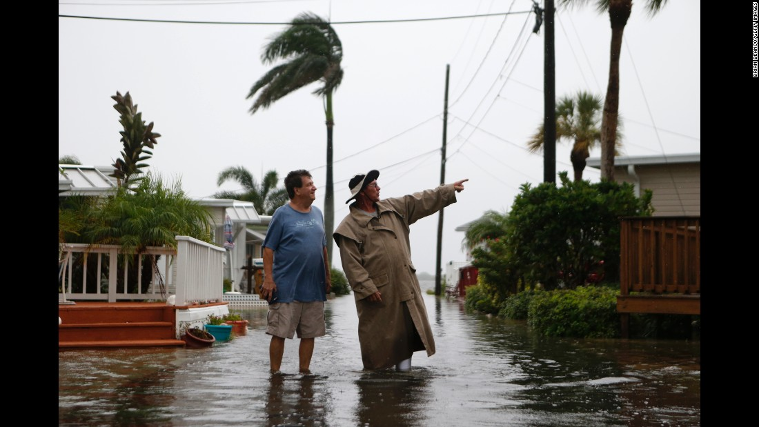 Residents of the Sandpiper Resort survey rising water in Holmes Beach, Florida, on September 1.