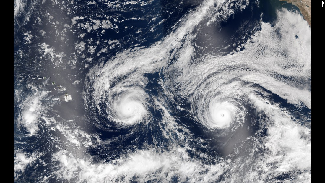 "The island of Hawaii rarely takes a direct hit from a hurricane, but two Pacific storms are lining up to change that. This satellite image shows Hurricane Madeline, left, and Hurricane Lester as they move closer to the state on Monday, August 29. Madeline has since been <a href=""http://www.cnn.com/2016/08/30/weather/tropical-storms-hurricanes-carolina-hawaii/"" target=""_blank"">downgraded to a tropical storm.</a>"