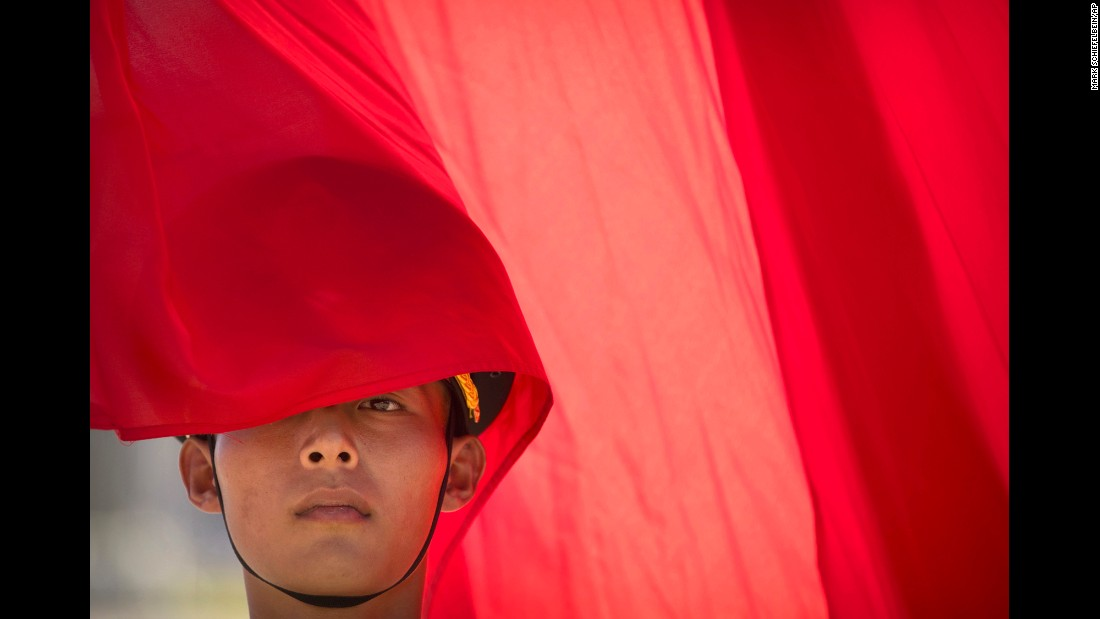 A member of a Chinese honor guard stands with a flag before a welcome ceremony in Beijing for Canadian Prime Minister Justin Trudeau on Wednesday, August 31.