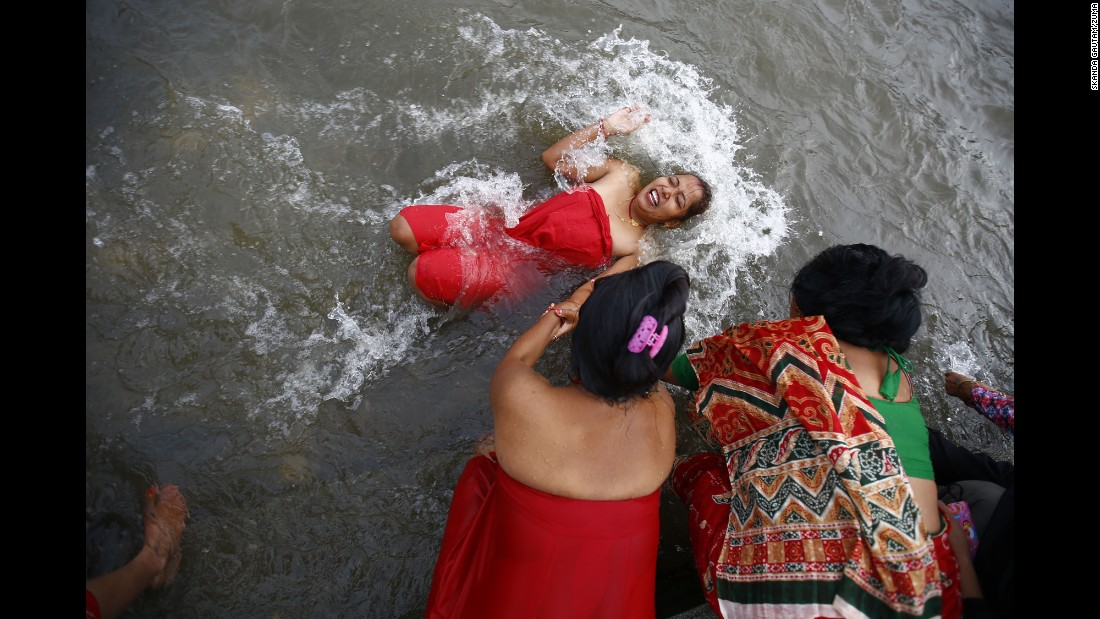 A Hindu devotee takes a holy dip in the Bagmati River to commemorate the Kuse Aunsi celebration in Kathmandu, Nepal, on Thursday, September 1.