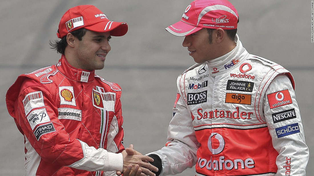 He would go on to enjoy his most successful period on the track with Ferarri, as the Brazilian clocked up 11 race wins and 36 podiums. Just a single point separated Massa from the championship in 2008 as he pushed McLaren's Lewis Hamilton (right) all the way.