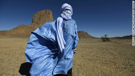A Tuareg poet in a blue robe poses for a photo in Tagmart plateau, around 30 kilometres (20 miles) outside Tamanrasset in Southern Algeria, on January 12, 2016.     The imzad, a single-stringed violin played only by Tuareg women, is making a comeback in Algeria as the last of its players come to the rescue of a tradition on the verge of extinction.     / AFP / Farouk Batiche / TO GO WITH AFP STORY BY AMER OUALI        (Photo credit should read FAROUK BATICHE/AFP/Getty Images)