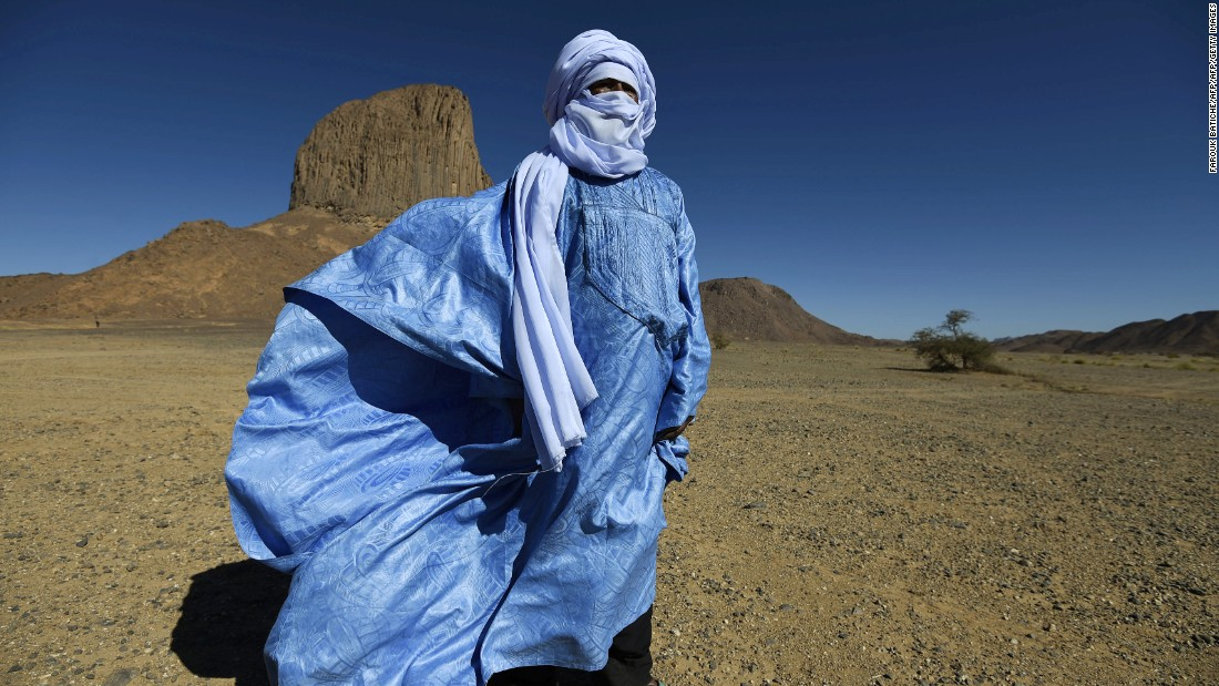 "Tuaregs are the only tribal communities in which <a href=""http://travel.cnn.com/surviving-sahara-468896/"">men wear veils instead of women</a>. The tangelmust, a wrapped headdress up to eight meters in length, is ubiquitous among the ""blue men of the desert."" The name does not allude to the muslin headdress, dyed with indigo, but rather because the dye gradually leeches out into the skin of the wearer. Tuaregs use the tangelmust for practical reasons: it protects from the sun and sand, but men will still wear them at night, and even during meals. Men cover their faces with the tangelmust in front of strangers and women, while women are free to show their face."