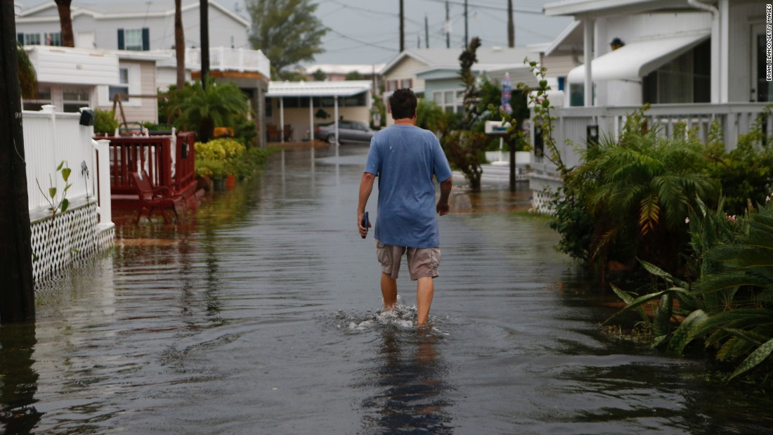 A Holmes Beach resident walks through the Sandpiper Resort on September 1.
