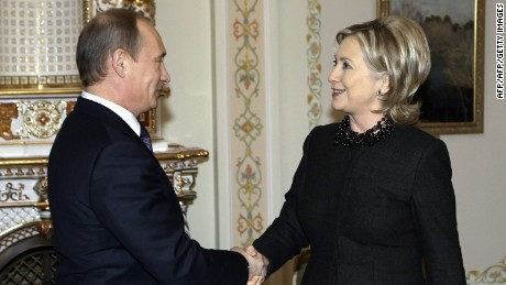 US Secretary of State Hillary Clinton (R) shakes hands with Russian Prime Minister Vladimir Putin (L) outside Moscow in Novo-Ogarevo on March 19, 2010. Russian Prime Minister Vladimir Putin met US Secretary of State Hillary Clinton and used the occasion to bemoan Moscow's stalled WTO application and the state of bilateral trade. Russia, the world's largest economy outside the global trade body, has repeatedly accused Washington of hindering its efforts to join the World Trade Organization in talks that have dragged on since 1993.