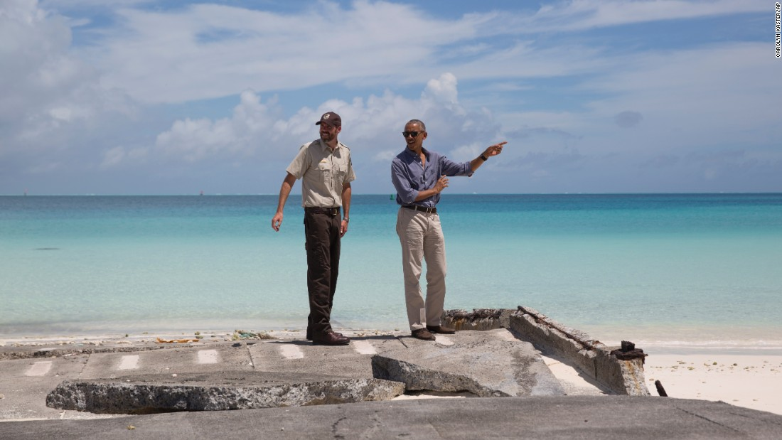 "U.S. President Barack Obama, right, visits Turtle Beach during <a href=""http://www.cnn.com/2016/09/01/politics/midway-obama-preview/"" target=""_blank"">a tour of the remote Midway Atoll, </a>which is off the coast of his native Hawaii on Thursday, September 1. Obama is expanding the Papahanaumokuakea Marine National Monument there, establishing the largest protected marine sanctuary in the world."