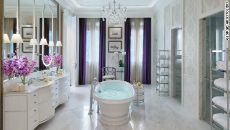 The bathroom of the Mandarin Oriental's presidential suite features splashes of purple Thai silk.