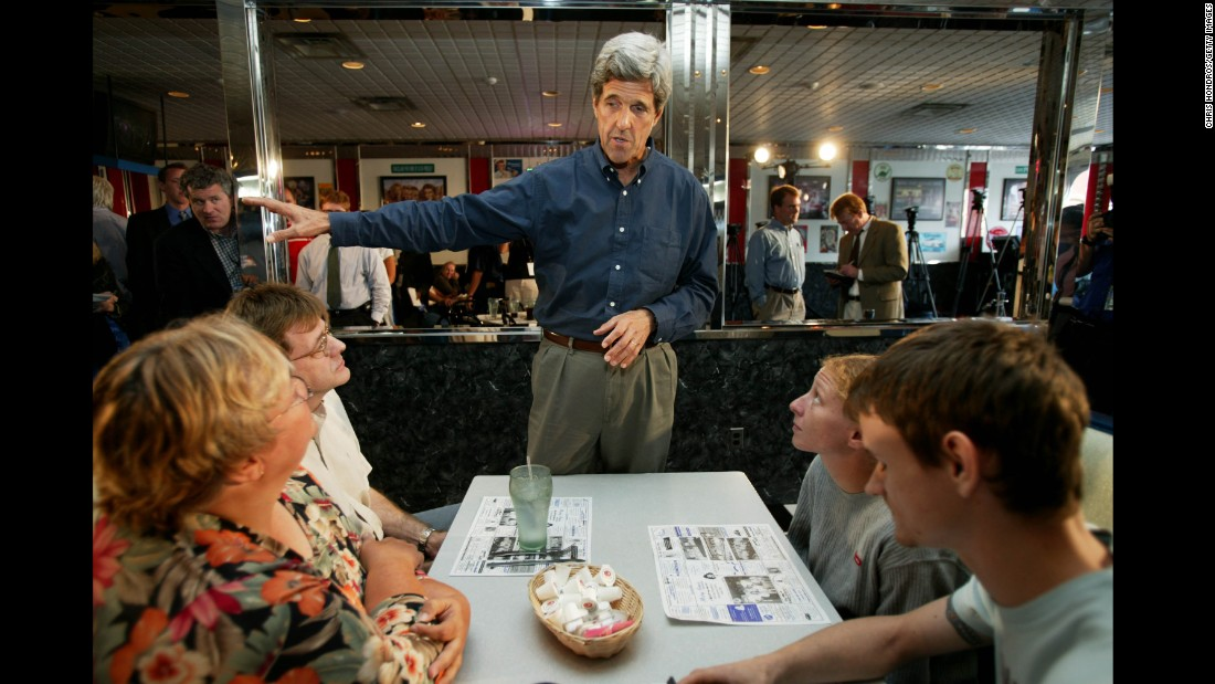 Kerry meets locals in a diner in Derry, New Hampshire, shortly after announcing his 2004 candidacy for president. Kerry would win the Democratic nomination, but lose the general election to President George W. Bush.