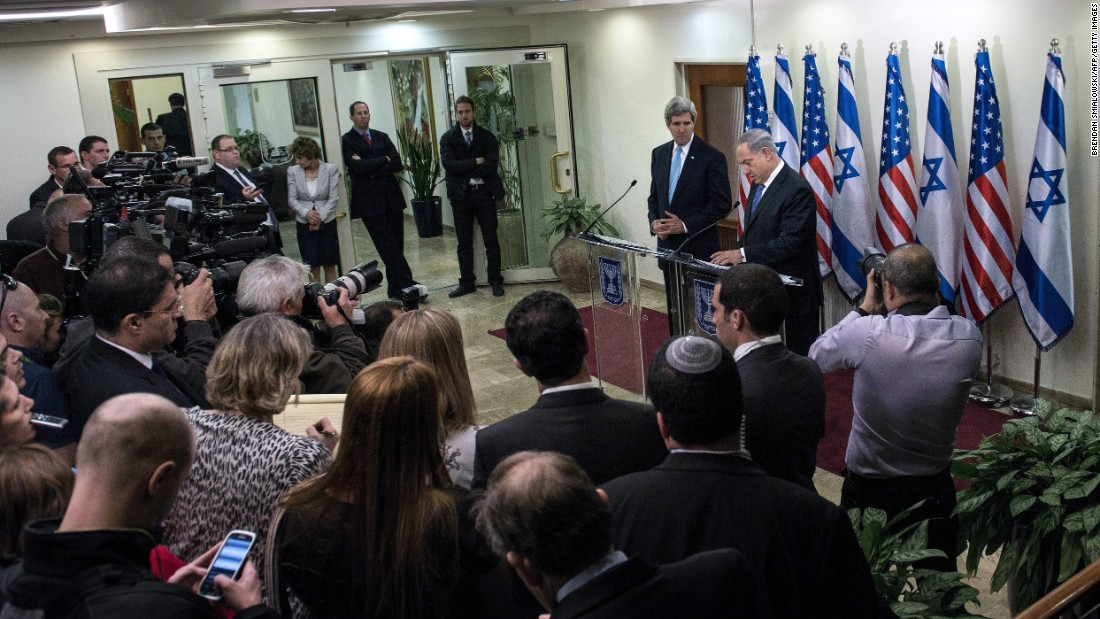 Kerry listens as Israeli Prime Minister Benjamin Netanyahu makes a statement to the press before a meeting in 2014 in Jerusalem.