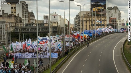 "Trade unions hold a protest march against economic policies adopted by the government of Mauricio Macri, in Buenos Aires on September 2, 2016. / AFP / TELAM / CARLOS BRIGO / XGTY   /  RESTRICTED TO EDITORIAL USE-MANDATORY CREDIT ""AFP PHOTO/TELAM"" NO MARKETING NO ADVERTISING CAMPAIGNS-DISTRIBUTED AS A SERVICE TO CLIENTS-GETTY OUT        (Photo credit should read CARLOS BRIGO/AFP/Getty Images)"