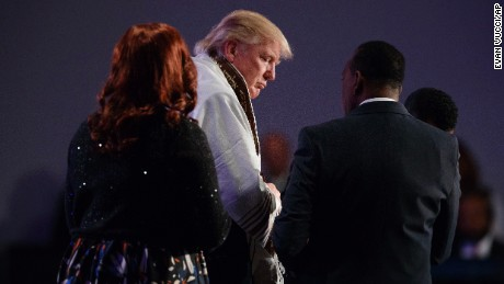 Donald Trump wears a prayer shawl during a church service at Great Faith Ministries, Saturday, September 3, in Detroit.