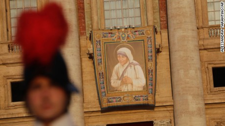 A tapestry showing Mother Teresa hangs from the facade of St.Peter's Basilica before the start of the canonization ceremony in St. Peter's Square at the Vatican, Sunday, Sept. 4, 2016. Thousands of pilgrims thronged to St. Peter's Square on Sunday for the canonization of Mother Teresa, the tiny nun who cared for the world's most unwanted and became the icon of a Catholic Church that goes to the peripheries to tend to lost, wounded souls. (AP Photo/Alessandra Tarantino)