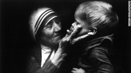 An undated file picture shows mother Teresa from Calcutta, holding a Polish child during a visit to Poland.