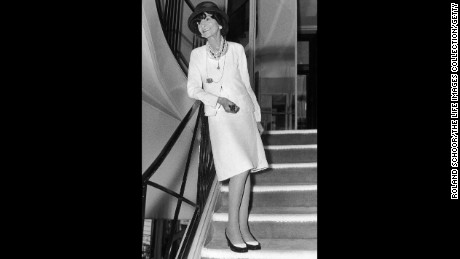 French fashion designer Coco Chanel wearing a dress of her own creation.