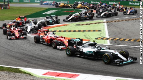 Nico Rosberg leads the Italian Grand Prix at the start after a slow get away by Mercedes team mate Lewis Hamilton.