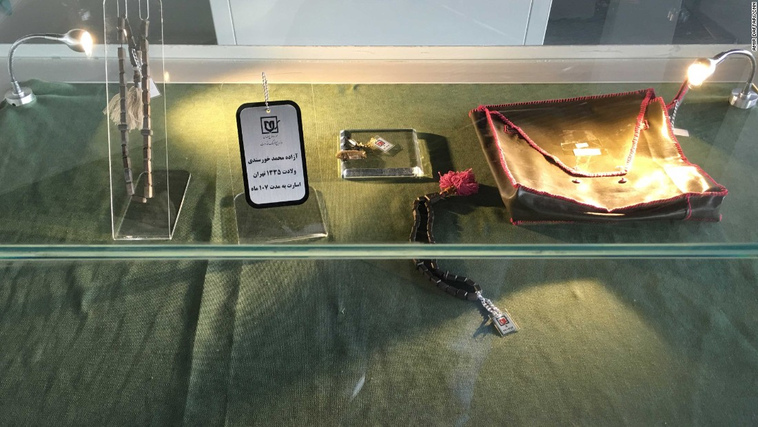 It's filled with display boxes resembling caskets, showcasing personal effects and intimate objects -- like these chains and bracelets -- found on the dead.
