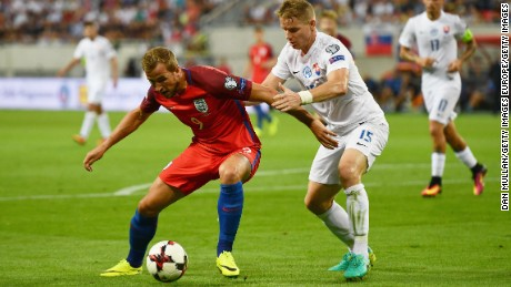 Harry Kane of England holds off Tomas Hubocan of Slovakia during the World Cup Group F qualifying match.