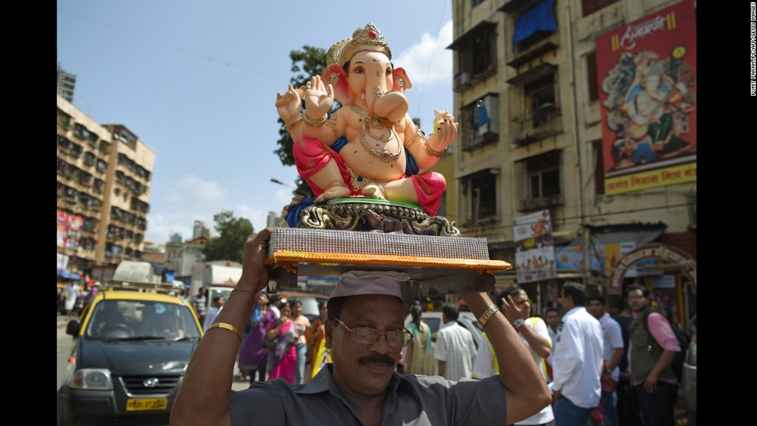 A Hindu devotee transports an elephant idol through the streets of Mumbai, India, on the first day of the festival, September 5. Hindu devotees bring home idols of Lord Ganesh in order to invoke his blessings for wisdom and prosperity.