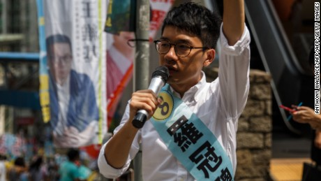Nathan Law, 23, a leader of the 2014 pro-democracy rallies, campaigns for his political party Demosisto party during the Legislative Council election in Hong Kong on September 4, 2016. Young Hong Kong independence activists calling for a complete break from China stood in major elections for the first time on September 4, the biggest vote since 2014 pro-democracy rallies.  / AFP / Anthony WALLACE        (Photo credit should read ANTHONY WALLACE/AFP/Getty Images)