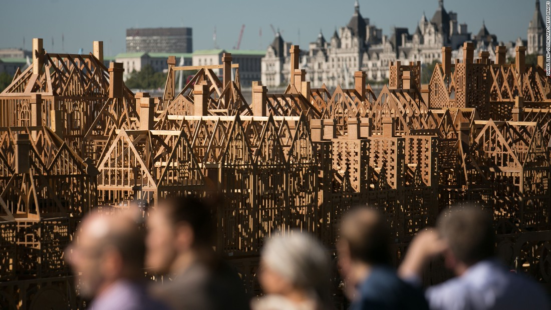 Final touches are made to the 120 metre-long (393 feet) wooden sculpture, designed by American sculptor David Best, that was  eventually set ablaze in the middle of the river Thames.