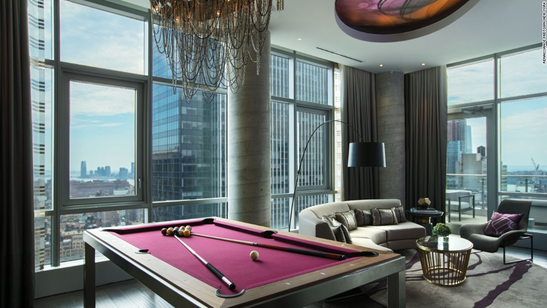 Perched on the 37th floor, the Renaissance New York Midtown's new Empire Suite features a living space complete with a pool table that can be transformed for dining.