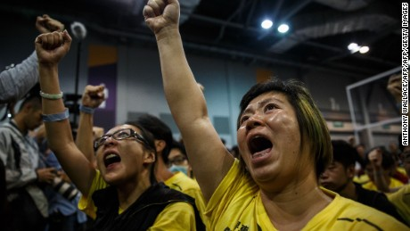 Supporters cheer as the results of Hong Kong's Legislative Council election are announced.