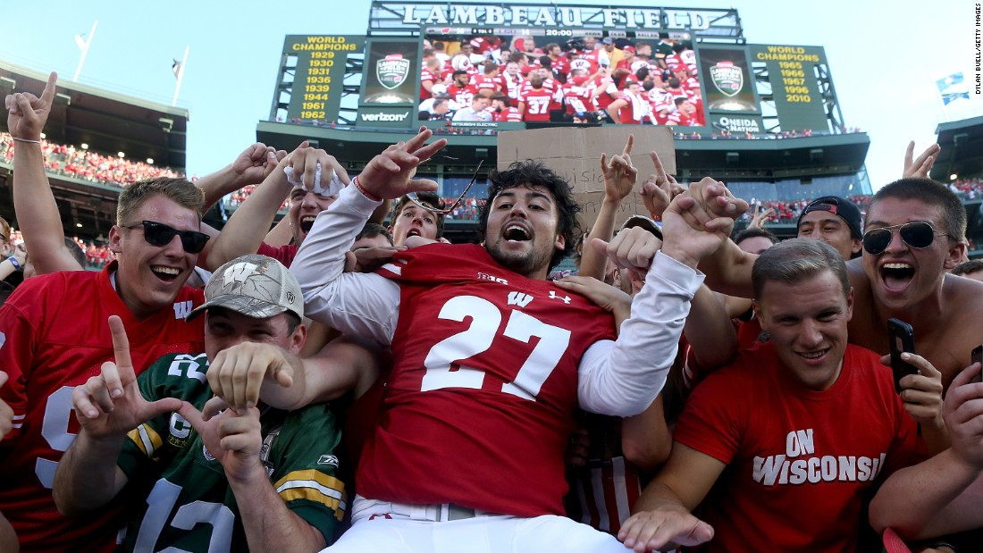 Wisconsin's Rafael Gaglianone, center, celebrates after his team beat Louisiana State University in Green Bay, Wisconsin, on Saturday, September 3. Wisconsin defeated LSU 16-14.