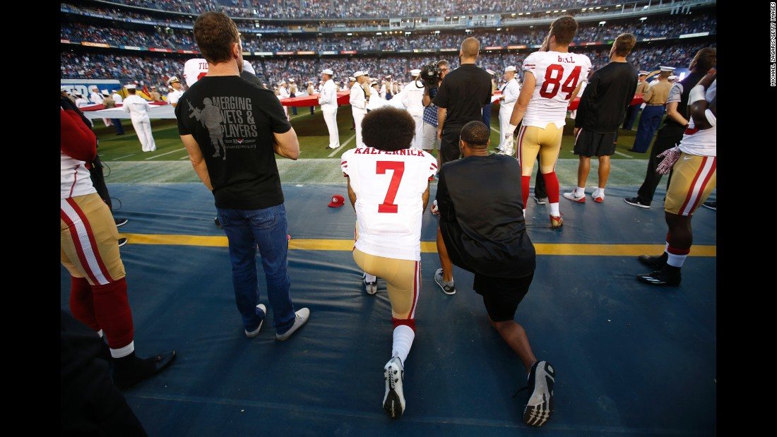 "Colin Kaepernick, left, and Eric Reid of San Francisco kneel during the national anthem before a game in San Diego on Thursday, September 1. Kaepernick has said <a href=""http://edition.cnn.com/2016/09/01/sport/nfl-preseason-49ers-chargers-colin-kaepernick-national-anthem/"" target=""_blank"">he would refuse to stand during the national anthem</a> because he will not ""show pride in a flag for a country that oppresses black people and people of color."""