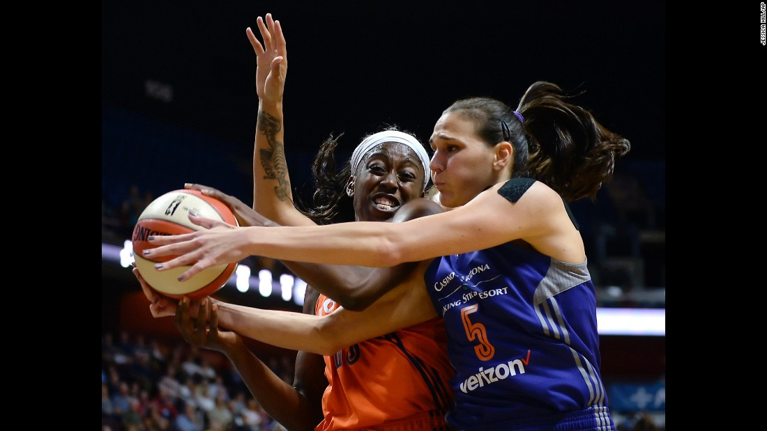 Connecticut's Chiney Ogwumike, left, and Sonja Petrovic of Phoenix battle for a rebound during a game in Uncasville, Connecticut, on Friday, September 2. Phoenix lost 74-87.