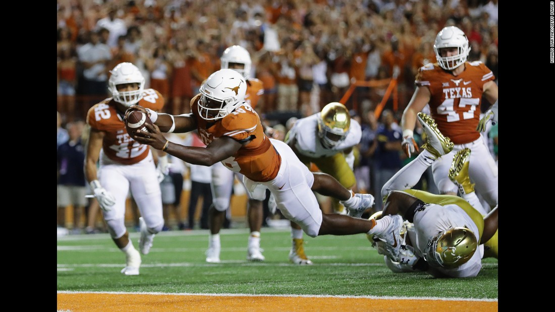 Tyrone Swoopes of the University of Texas goes for the game-winning touchdown against Notre Dame in Austin, Texas, on Sunday, September 4. Notre Dame lost 47-50.